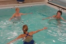 A photo of three people working out in an aqautic therapy pool