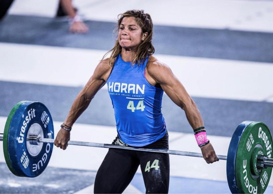 A woman lifting a heavy barbell.