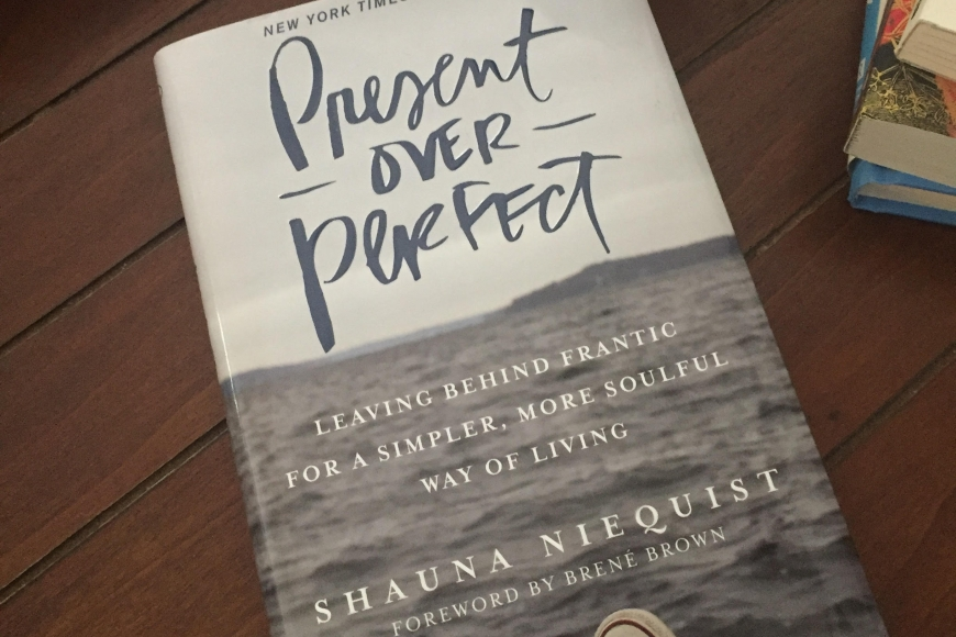 A photo of the cover of the book present over perfect