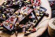 A photo of a few pieces of dark chocolate bark on a platter