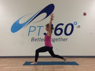 At a PT360 yoga class, a woman performs the crescent lunge pose.