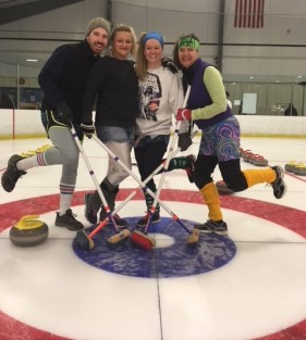 The PT360 staff poses on a curling rink.