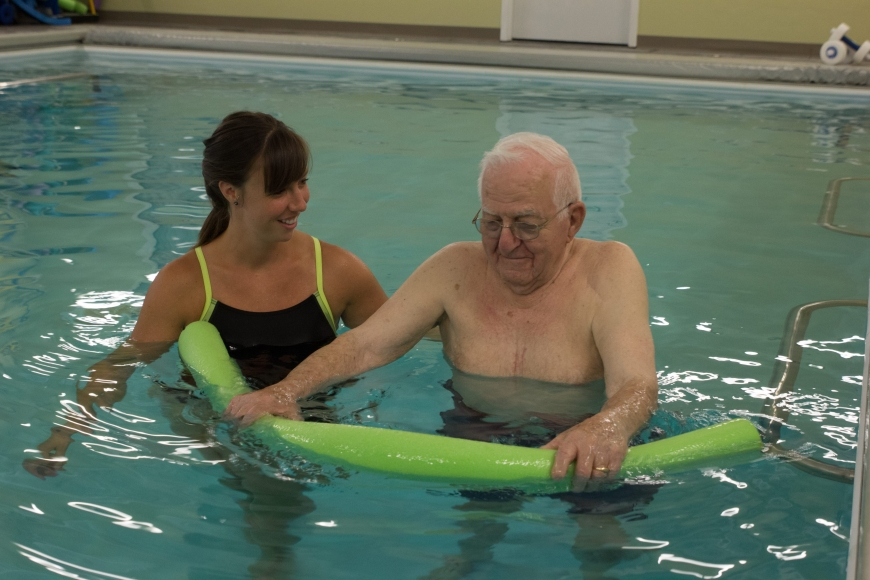 A photo of a physical therapist working with a patient in the PT360 aquatic therapy pool
