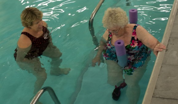 Two patients work out in the aquatic therapy pool