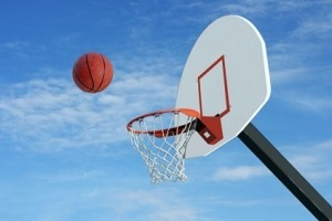 An image of a basketball going into a basket