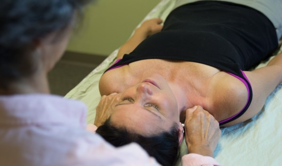 A patient suffering from Lymphedema gets hands on therapy from a physical therapist.