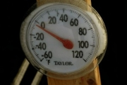 A picture of a dial thermometer reading around zero degrees