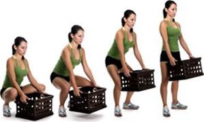 A photo of a woman lifting a box with proper form.