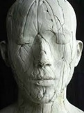 A photo of sculpture of a human head.