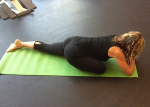 A woman posing in a PT360 yoga class